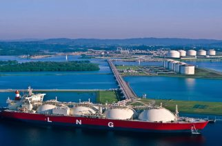 Liquid Natural Gas tanker at port with LNG, Liquid Natural Gas, Natural Gas, Fossil fuel, Oil Industry, Industry, Oil, Tanker, Freight Transportation, Sailing Ship, Shipping, Industrial Ship, Cargo,  Industry, Electricity Production, Power,  Energy, Technology, Environmental, Environment Friendly,Ecology, Global Warming, Environmental Damage, Oil,Industrial Area, LNG Tank, Blue sky, Ocean, Sea, Cloudsin background.