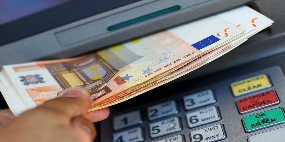 ATHENS, GREECE - JUNE 22:  Fifty Euro notes are pictured coming out of an ATM machine on June 22, 2011 in Athens, Greece. Eurozone finance ministers are currently seeking to find a solution to Greece's pressing debt problems, including the prospect of the country's inability to meet its financial obligations unless it gets a fresh, multi-billion Euro loan by July 1. Greece's increasing tilt towards bankruptcy is rattling worldwide financial markets, and leading economists warn that bankruptcy would endanger the stability of the Euro and have dire global consequences.  (Photo by Vladimir Rys/Getty Images)