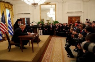 U.S. President Donald Trump signs a proclamation on Greek Independence Day during a celebration at the White House in Washington, U.S., March 18, 2019. REUTERS/Carlos Barria